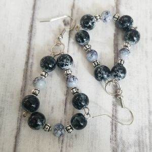 Black, white and silver toned dangle earrings